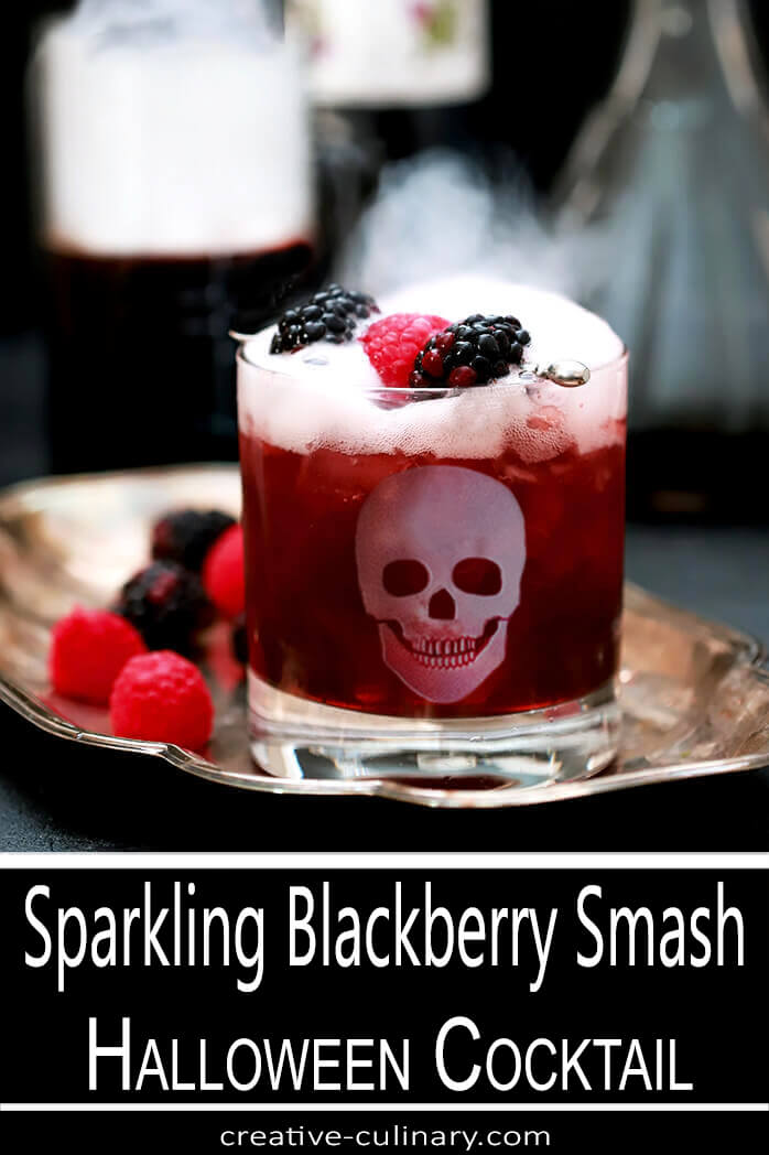 Sparkling Blackberry Smash Cocktail in Highball Glass Garnished with Blackberries and Raspberries