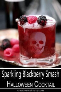 Sparkling Blackberry Smash Cocktail in Highball Glass with Etched Skull
