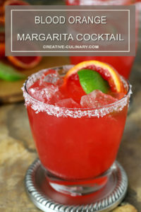 Blood Orange Margarita Cocktail with a Salt and Sugar Rim and Garnished with Fruit Slices