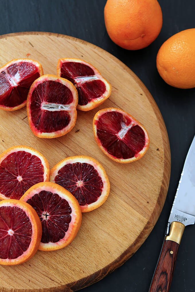 Blood Oranges Cut Open on Wood Cutting Board