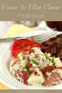 Bacon Blue Cheese Potato Salad on a Plate with Tomatoes and Beef