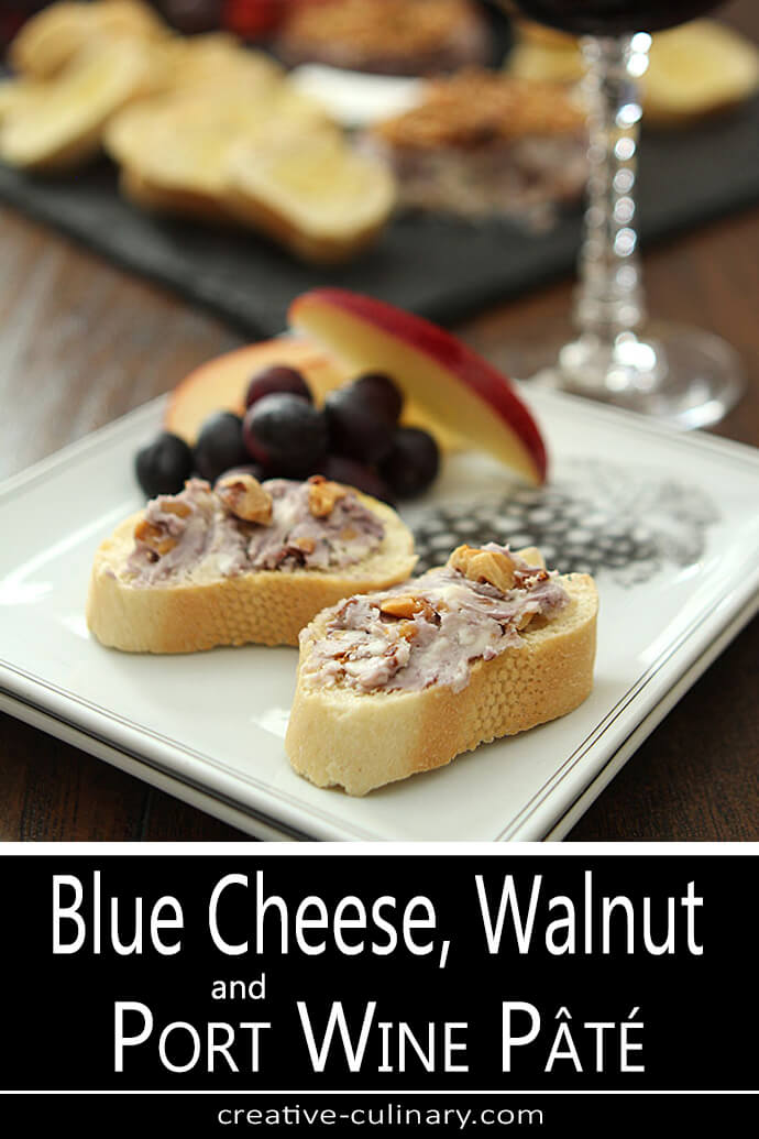 Blue Cheese, Toasted Walnuts, and Port Wine Pate on A White Plate with French Baguette Slices and Grapes