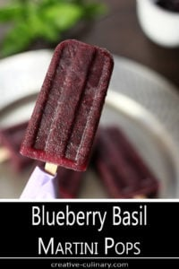 Blueberry Basil Martini Pops on a Wooden Stick with a Purple Napkin