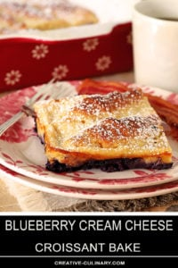 Slice of Blueberry Cream Cheese Croissant Bake White and Rose Plate