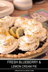 Whole Blueberry and Lemon Cream Pie Garnished with Lemon Slices and Zest