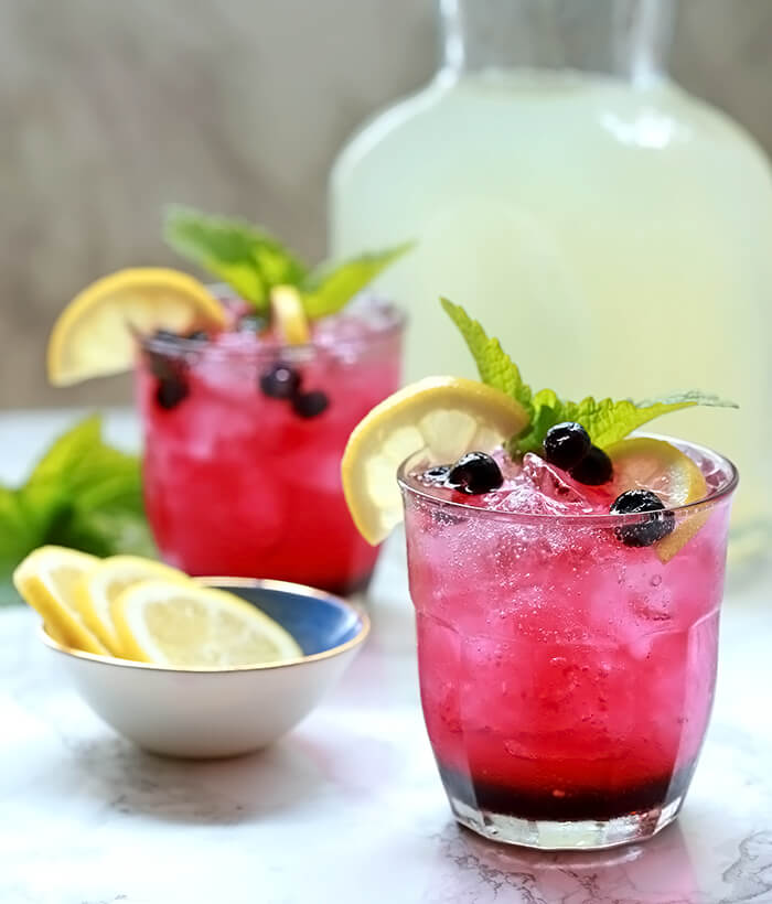 Sparkling Lemonade and Blueberry Cocktails Served with Lemon Slices and Mint