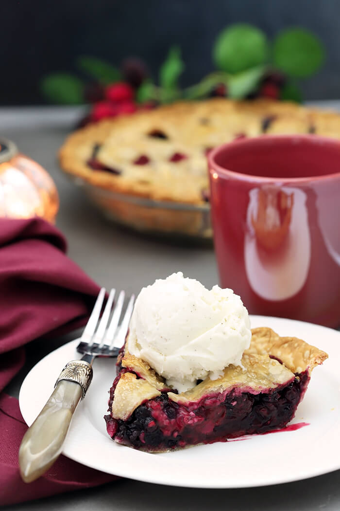 A Slice of Booberry (Mixed Berry Pie) with Vanilla Ice Cream on Top