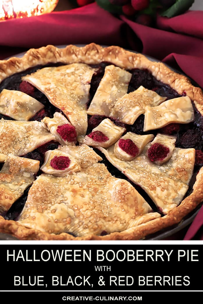 This Halloween Booberry Pie has Mixed Berries and a Design on Top with Pastry That Looks Like Fingers Grasping From Below
