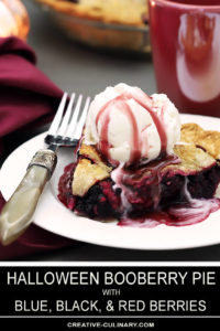 A Slice of Booberry (Mixed Berry Pie) with Vanilla Ice Cream on Top Drizzled with Pomegranate Syrup