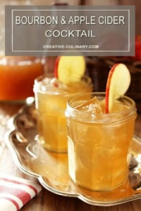 Bourbon and Apple Cider Cocktail with Ginger Beer Garnished with an Apple Slice