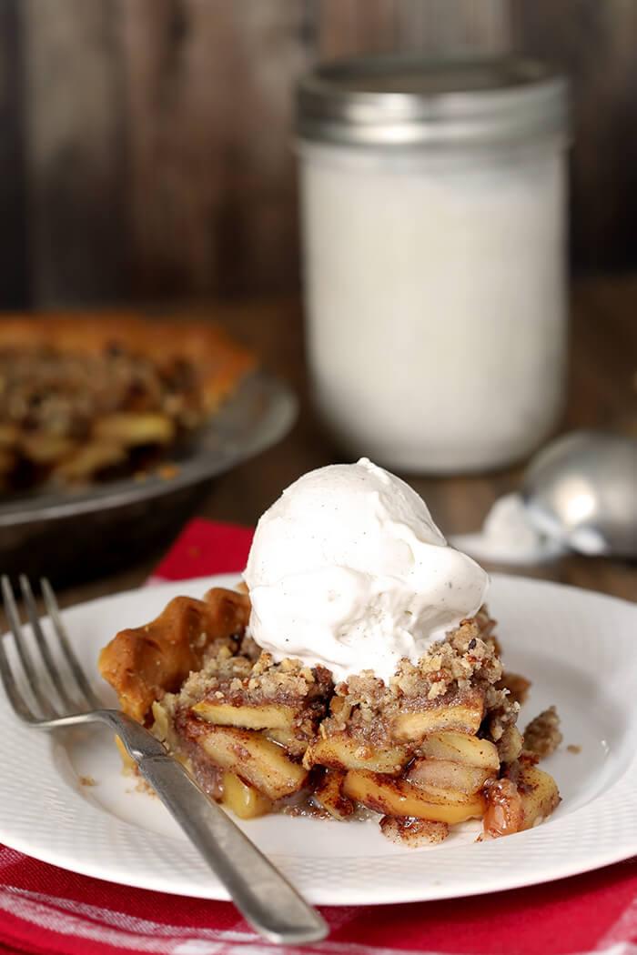 Slice of Bourbon Caramel Apple Pie with Pecan Crumble with Vanilla Bean Ice Cream