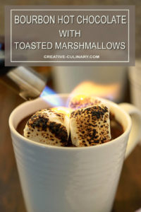 Bourbon Hot Chocolate with Toasted Marshmallow in a Cup Being Torched
