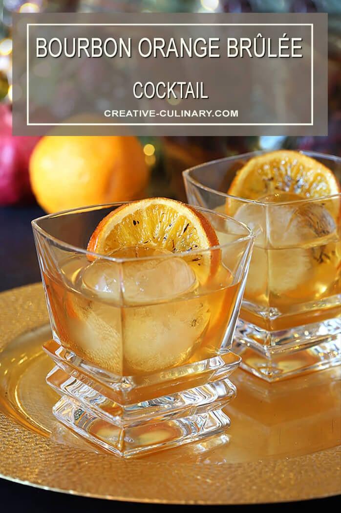 Two Bourbon Orange Brûlée Cocktails on Gold Serving Tray