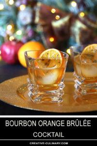 Two Bourbon Orange Brûlée Cocktails on Gold Serving Tray with Orange Garnish