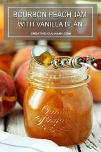 Jar of Bourbon Peach Jam with Jeweled Serving Spoon Filled with Jam