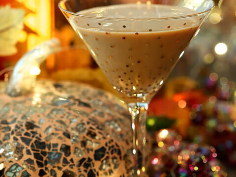 Bourbon Pumpkin Cocktail with Chocolate Liqueur Served in a Martini Glass with Gold Polk-a-dots