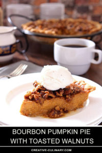 Slice of Bourbon Pumpkin Pie with Toasted Walnuts Topped with Whipped Cream