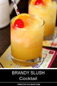Brandy Slush Cocktails Garnished with Orange Slice and Maraschino Cherry