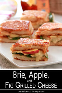 Bried, Apple, and Fig Grilled Cheese Sandwich served on a White Plate