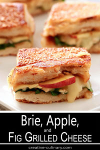 Bried, Apple, and Fig Grilled Cheese Sandwiches On Serving Plate