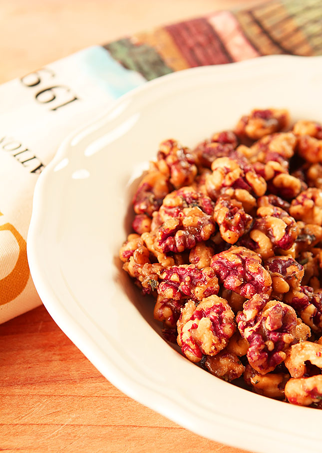 Brown Sugar and Cayenne Candied Walnuts on a White Plate