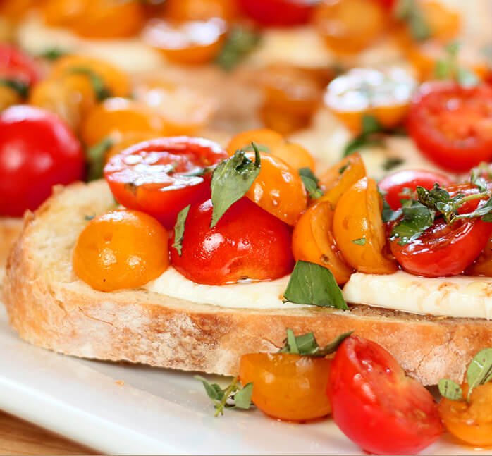 Warm Tomato Mozzarella Bruschetta Garnished with Basil