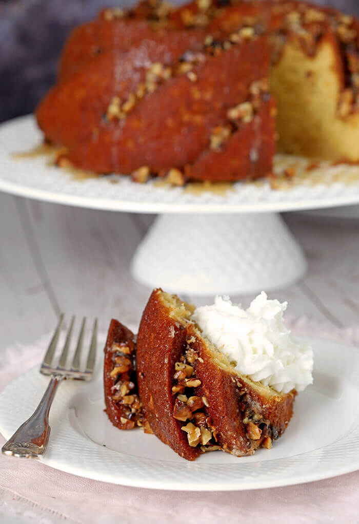 Slice of Easy Rum Cake with Butter Rum Glaze and Whipped Cream