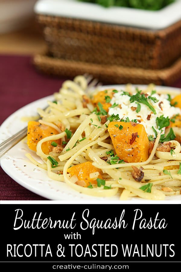 Roasted Butternut Squash Pasta with Ricotta and Toasted Walnuts on a Plate Garnished with Parsley