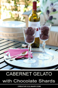 Cabernet Gelato with Chocolate Shards Served on an Outdoor Table in a Wine Glass