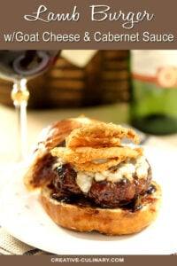 Lamb Burger with Goat Cheese and Cabernet Wine Sauce Topped with Fried Onion Rings