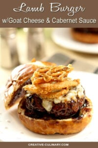 Lamb Burger with Goat Cheese and Cabernet Wine Sauce Topped with Fried Onion Rings and Served on a Bun