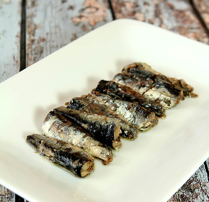 Whole Anchovies on a White Plate