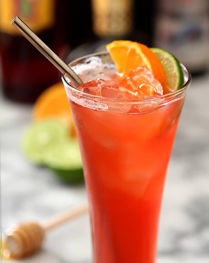 Summer Campari Cocktail with Orange and Lime Garnish