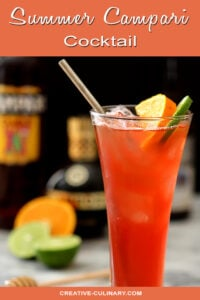 Summer Campari Cocktail in a Tall Glass with a Straw and Garnished with Orange and Lime