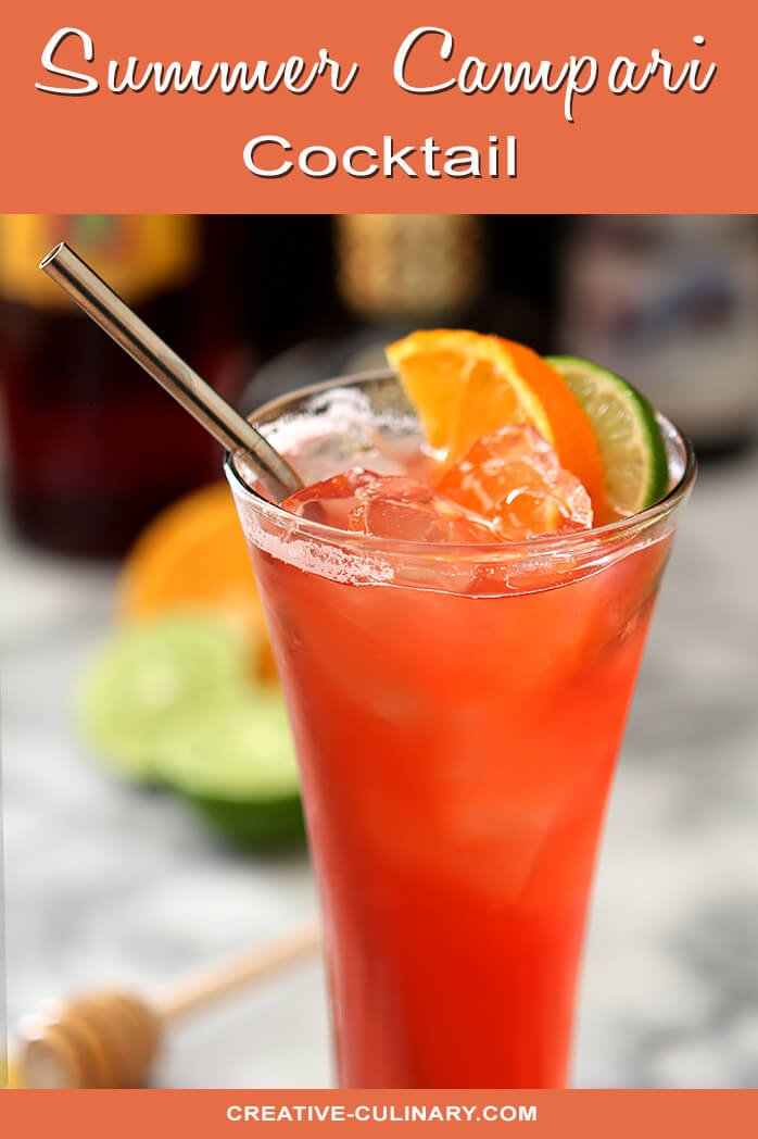 Summer Campari Cocktail in a Tall Glass Garnished with Orange and Lime