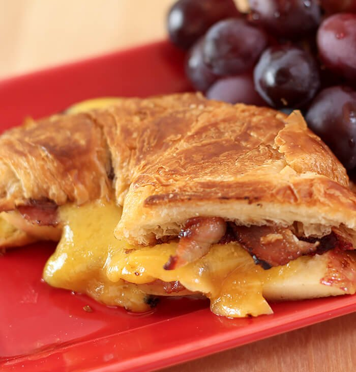 Cheddar, Pancetta, and Apple Grilled Cheese on Croissant Served with Dark Grapes