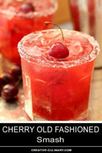 Cherry Old Fashioned Smash Cocktail with Sugared Rim and Garnished with Fresh Cherry