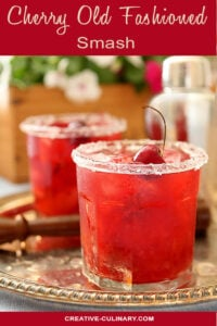 Two Cherry Old Fashioned Smash Cocktails Garnished with Fresh Cherry