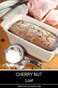 Loaf of Cherry Nut Bread Sprinkled with Powdered Sugar
