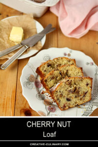 Slices of Cherry Nut Loaf with Cherries and Walnuts with Butter on the Side