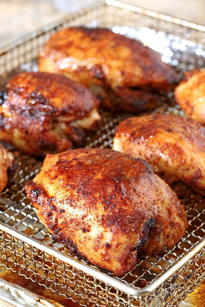 Air Fryer Chicken Thighs with Brown Sugar and Spices On Oven Fryer Tray with Beautiful Brown Color