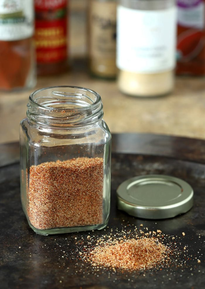 Spice Mix Used Honey Brushed Chicken Thighs in a Small Glass Bottle