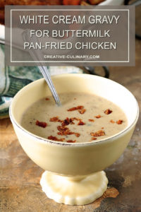 White Gravy from Old Fashioned Pan Fried Chicken Drippings in a Yellow Serving Bowl