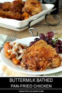 Old Fashioned Pan Fried Chicken on a Plate with Grapes and Roasted Vegetables with White Chicken Gravy