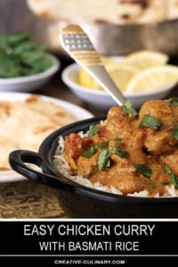 Easy Chicken Curry in Bowl and Table filled with Bread and Condiments