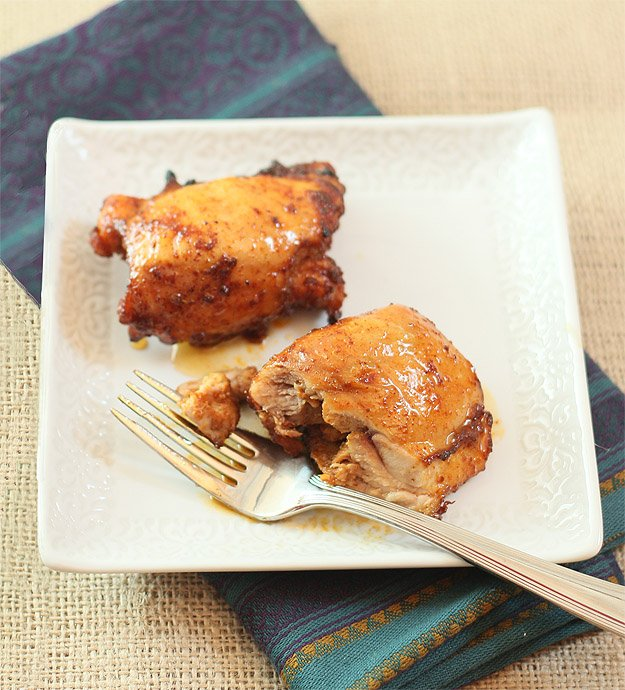 Broiled Honey Brushed Chicken Thighs with Spices and Honey on a Square Dish