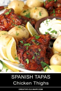 Spanish Tapas Chicken Thighs Served on a Large Platter with Potatoes and Garlic Aioli