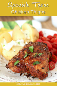 Spanish Tapas Chicken Thighs Garnished with Parsley and Served with Potatoes and Garlic Aioli with Cherry Tomatoes
