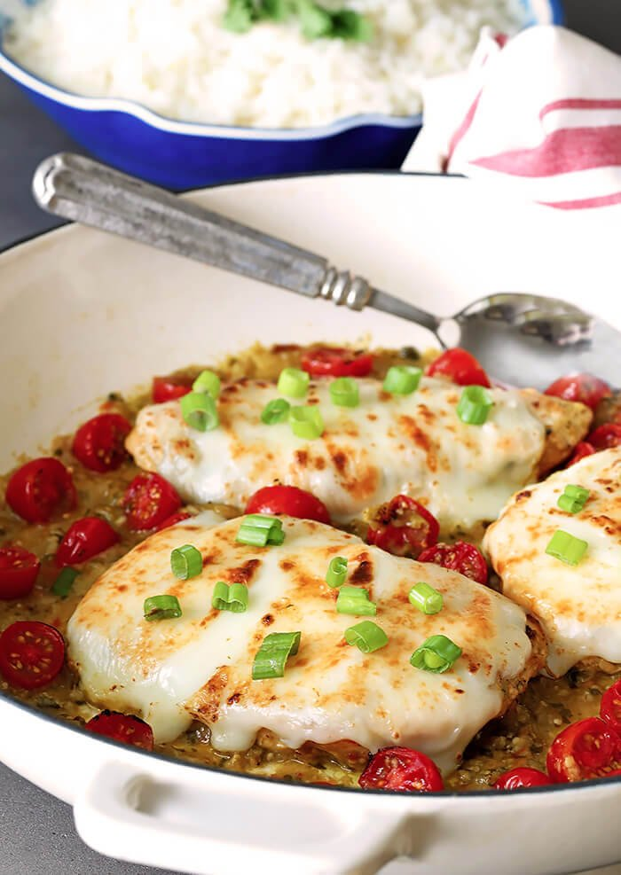 Tomatillo Salsa Verde Chicken Breasts in a Skillet with Cherry Tomatoes