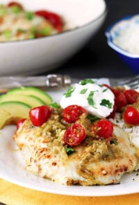 Tomatillo Salsa Verde Chicken Breasts Served with Cherry Tomatoes, Avocado and Sour Cream